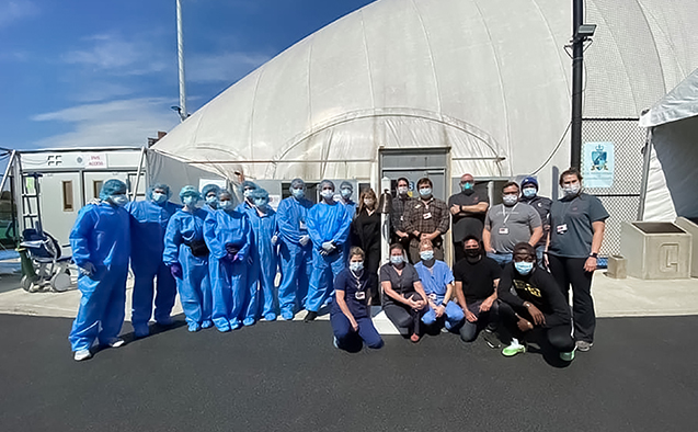 Various staff in front of bubble